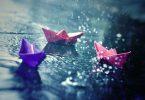 paper boats in rain
