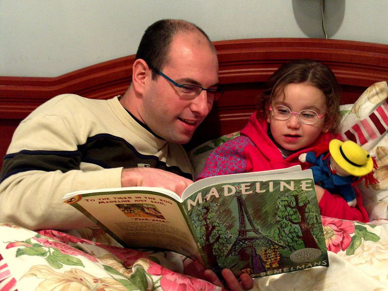 father and daughter reading