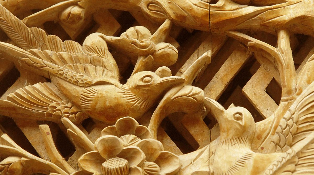 wood carving birds and trees