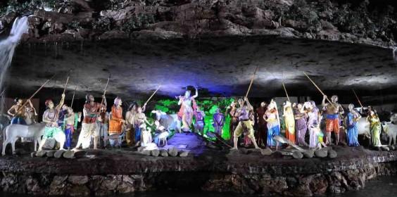 Krishna Holding Govardhan Giri Villagers With Sticks